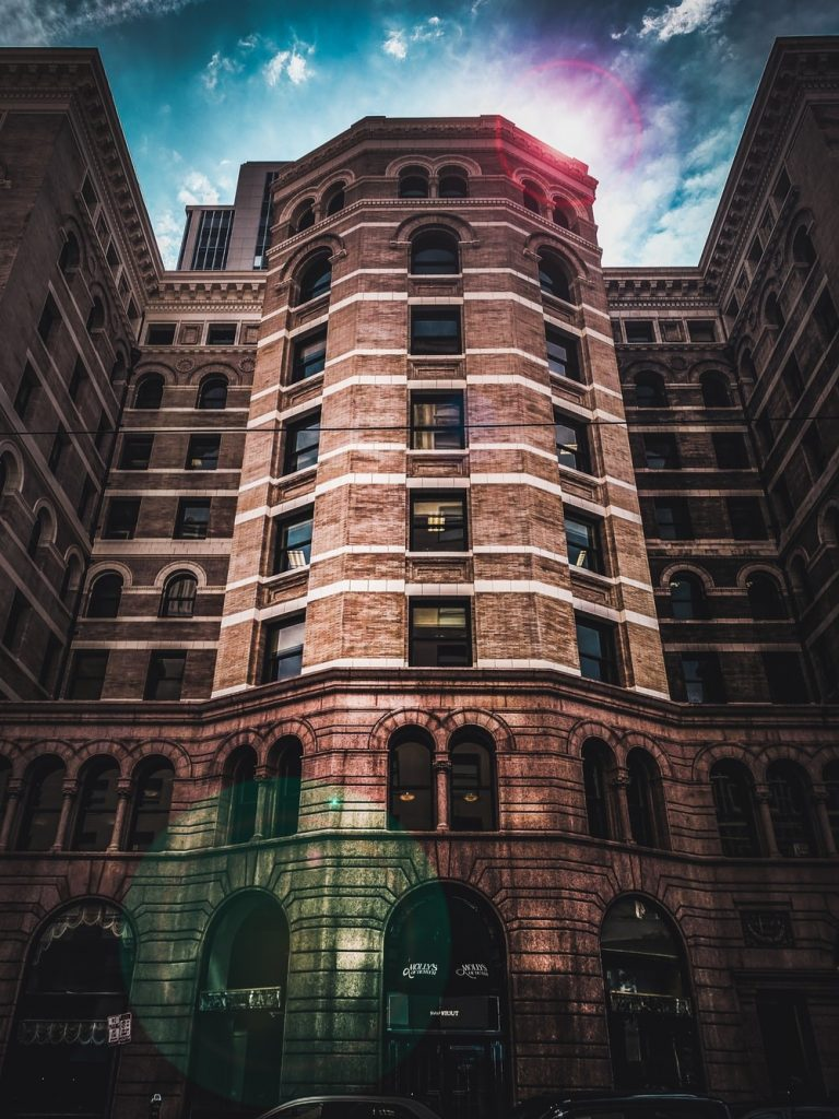 vignette photography of brown brick high-rise building